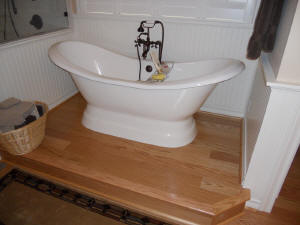Laminate flooring in your bathroom and around your tub.
